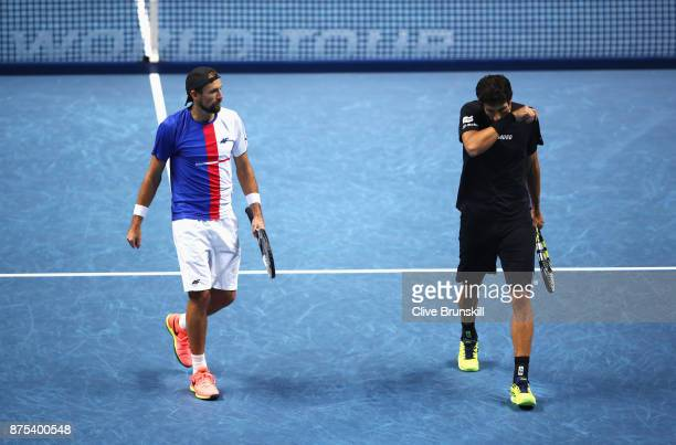 Lukasz Kubot of Poland and Marcelo Melo of Brazil look dejected in the Doubles match against Jamie Murray of Great Britain and Bruno Soares of Brazil...