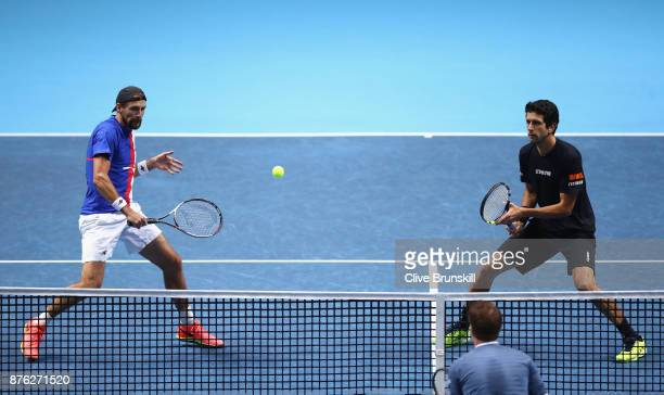 Lukasz Kubot of Poland and Marcelo Melo of Brazil return the ball during the doubles final against John Peers of Australia and Henri Kontinen of...