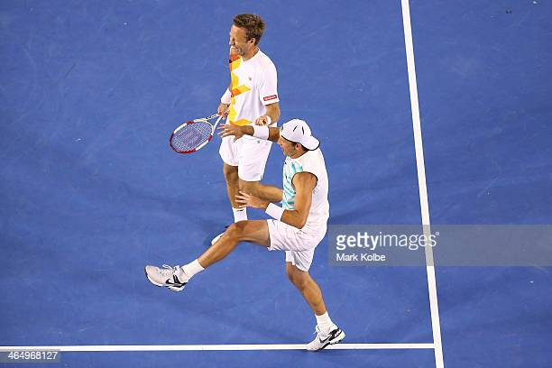 Lukasz Kubot of Poland and Robert Lindstedt of Sweden celebrate winning their Men's Doubles Final against Eric Butorac of the United States and Raven...