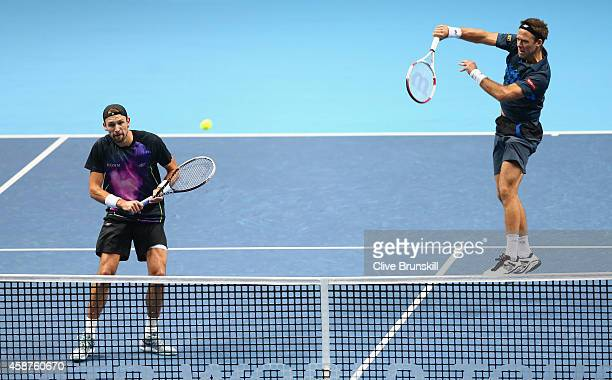 Lukasz Kubot of Poland and Robert Lindstedt of Sweden in action against Bob Bryan and Mike Bryan of United States in the round robin doubles on day...