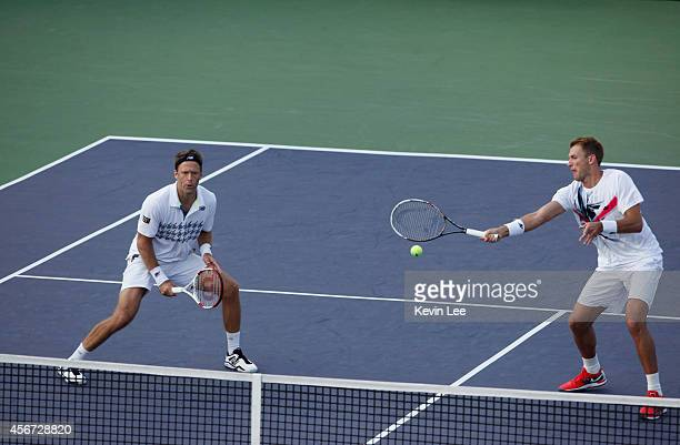 Lukasz Kubot of Poland and Robert Lindstedt of Sweden plays against Di Wu and Ze Zhang of China on day 2 of the Shanghai Rolex Masters at Zi Zhong...