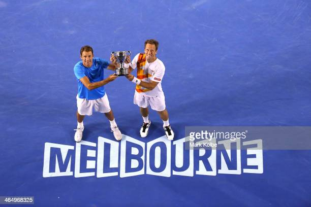 Lukasz Kubot of Poland and Robert Lindstedt of Sweden pose with the winners trophy after winning their Men's Doubles Final against Eric Butorac of...