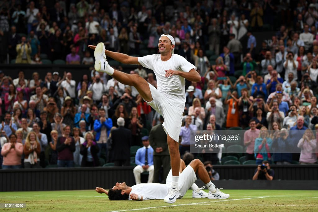LONDON, ENGLAND - JULY 15 Lukasz Kubot of Poland dances in celebration as Marcelo Melo of Brazil looks on after victory in the Gentlemen's Doubles final against Oliver Marach of Austria and Mate Pavic of Croatia on day twelve of the Wimbledon Lawn Tennis Championships at the All England Lawn Tennis and Croquet Club at Wimbledon on July 15, 2017 in London, England.