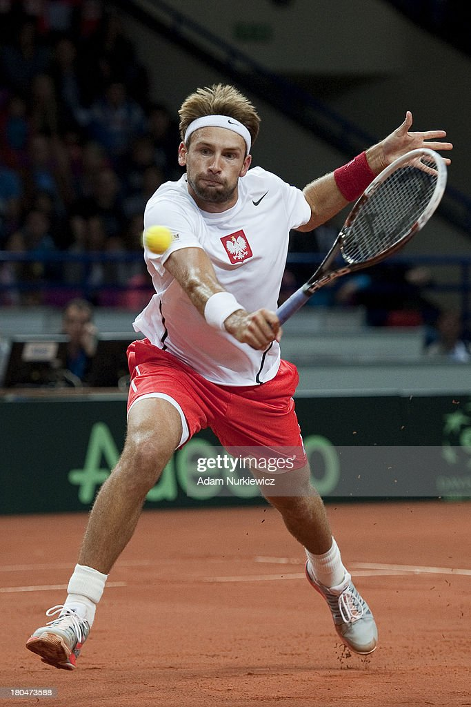 <a gi-track='captionPersonalityLinkClicked' href=/galleries/search?phrase=Lukasz+Kubot&family=editorial&specificpeople=835499 ng-click='$event.stopPropagation()'>Lukasz Kubot</a> of Poland in action during the Davis Cup match between Poland and Australia at the Torwar Hall, on September 13, 2013 in Warsaw, England.