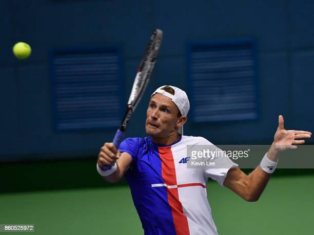 Lukasz Kubot of Poland in action in the match between Lukasz Kubot of Poland and Marcelo Melo of Brazil and Feliciano Lopez of Spain and Marc Lopez...