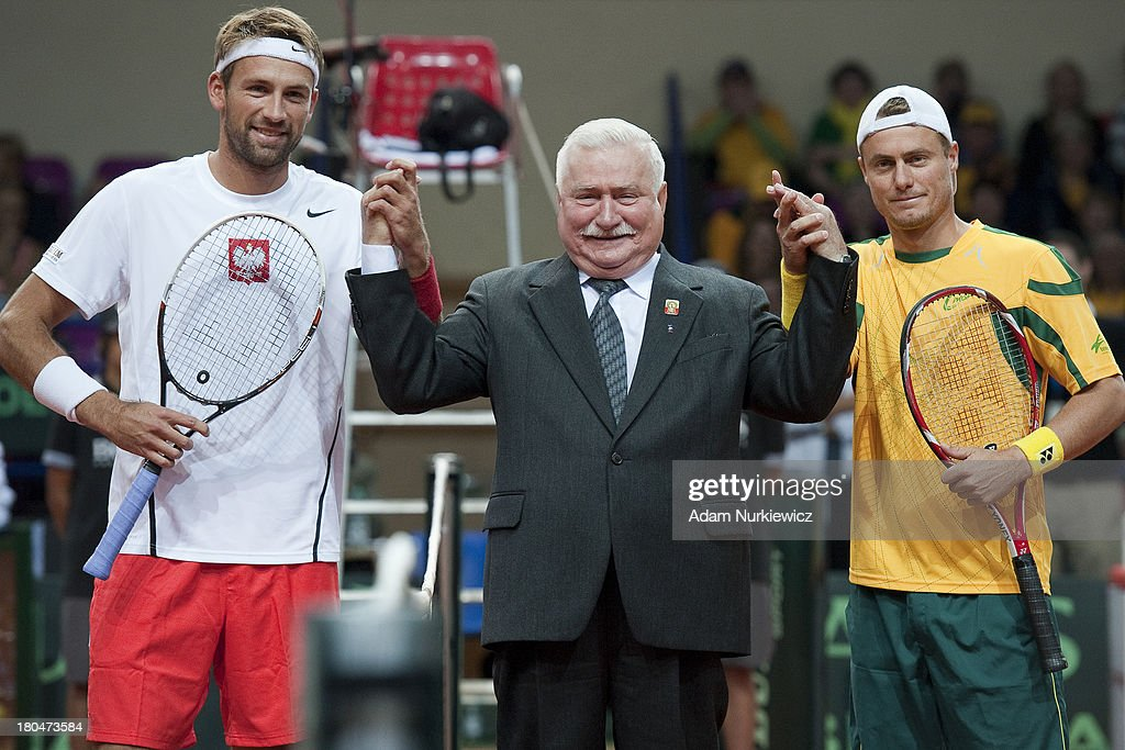Lukasz Kubot of Poland & (C) Lech Walesa former President of Poland & (R) Lleyton Hewitt from Australia before the Davis Cup match between Poland and Australia at the Torwar Hall, on September 13, 2013 in Warsaw, England.