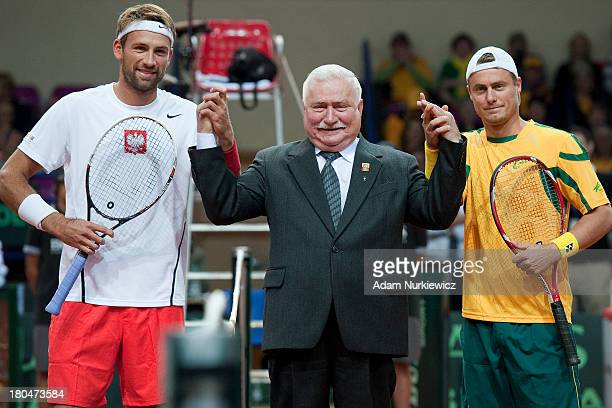 Lukasz Kubot of Poland Lech Walesa former President of Poland Lleyton Hewitt from Australia before the Davis Cup match between Poland and Australia...
