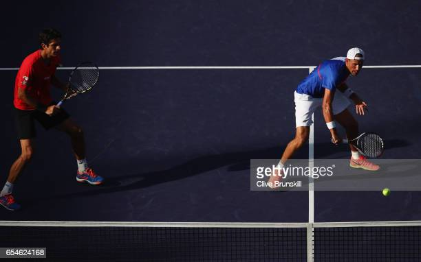 Lukasz Kubot of Poland plays a backhand during his doubles semi final match with partner Marcelo Melo of Brazil against Bruno Soares of Brazil and...