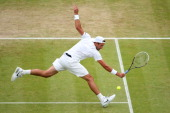 Lukasz Kubot of Poland plays a backhand during the Gentlemen's Singles quarterfinal match against Jerzy Janowicz of Poland on day nine of the...
