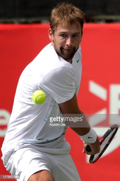 Lukasz Kubot of Poland plays a backhand in his first round match against Ernest Gulbis of Latvia during day two of the Rakuten Open at Ariake...