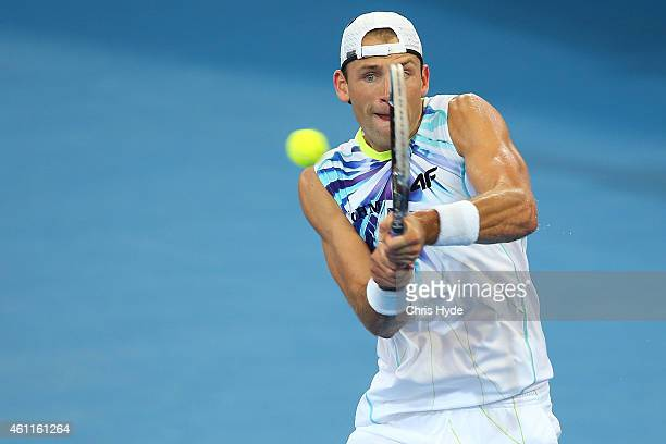 Lukasz Kubot of Poland plays a backhand in his match against Sam Groth of Australia during day five of the 2015 Brisbane International at Pat Rafter...