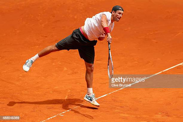 Lukasz Kubot of Poland serves against Gilles Simon of France in their second round match during day five of the Mutua Madrid Open tennis tournament...