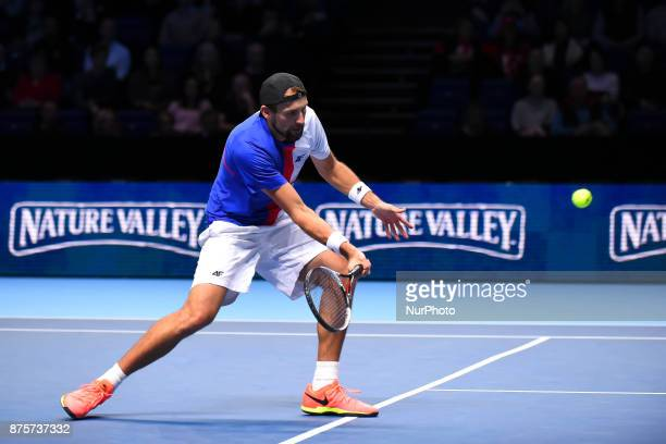 Lukasz Kubot returns backhand to Michael Venus during their men's doubles semifinal match on day seven of the ATP World Tour Finals tennis tournament...