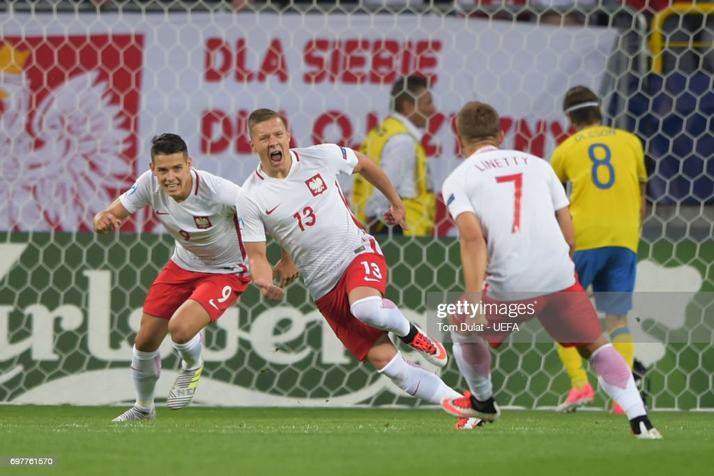 Lukasz Moneta (#13) of Poland celebrates scoring the opening goal during the UEFA European Under-21 Championship Group A match between Poland and Sweden at Lublin Stadium on June 19, 2017 in Lublin, Poland.
