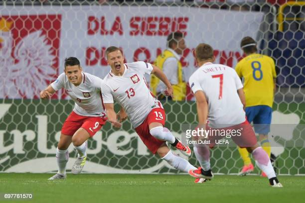 Lukasz Moneta of Poland celebrates scoring the opening goal during the UEFA European Under21 Championship Group A match between Poland and Sweden at...