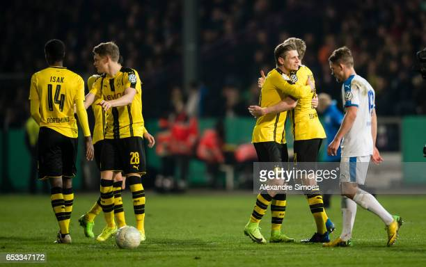 Lukasz Piszczek and Andre Schuerrle of Borussia Dortmund celebrate the win after the finale whistle during the DFB Cup Quarter Final match between...
