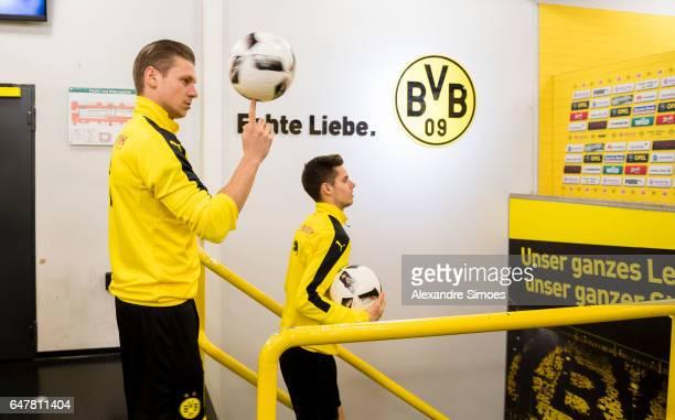Lukasz Piszczek and Julian Weigl of Borussia Dortmund at the mixed zone prior to the Bundesliga match between Borussia Dortmund and Bayer 04...