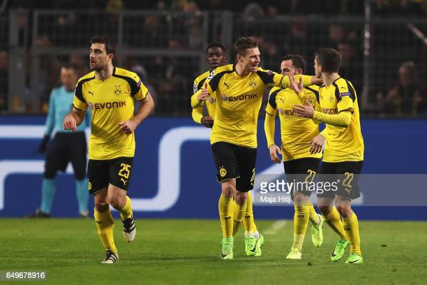 Lukasz Piszczek Gonzalo Castro and Christian Pulisic of Borussia Dortmund celebrate a goal during the UEFA Champions League Round of 16 second leg...