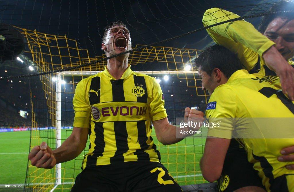 Lukasz Piszczek Nuri Sahin and Mats Hummels of Borussia Dortmund celebrate victory in the UEFA Champions League quarterfinal second leg match between...