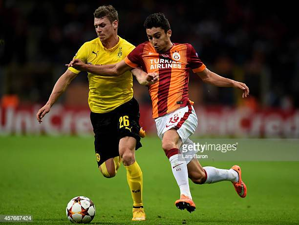 Lukasz Piszczek of Borussia Dortmund and Alex Telles of Galatasaray compete for the ball during UEFA Champions League Group D match between...