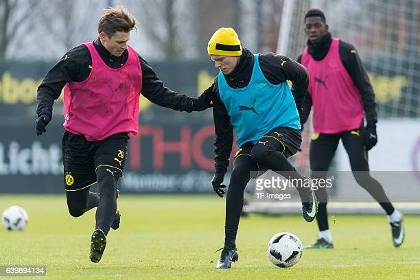 Lukasz Piszczek of Borussia Dortmund and Dzenis Burnic of Borussia Dortmund battle for the ball during a training session at the BVB Training center...