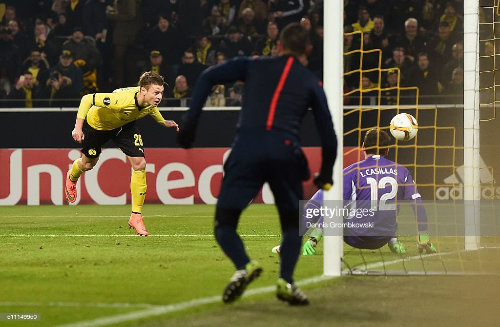 Lukasz Piszczek of Borussia Dortmund beats goalkeeper Iker Casillas of FC Porto to score their first goal during the UEFA Europa League round of 32...