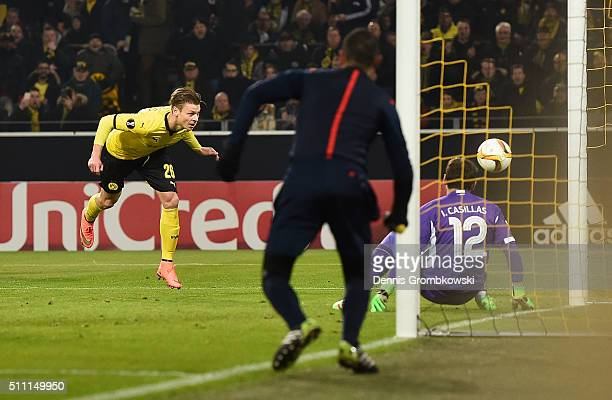 Lukasz Piszczek of Borussia Dortmund beats goalkeeper Iker Casillas of FC Porto to score their first goal during the UEFA Europa League round of 32...