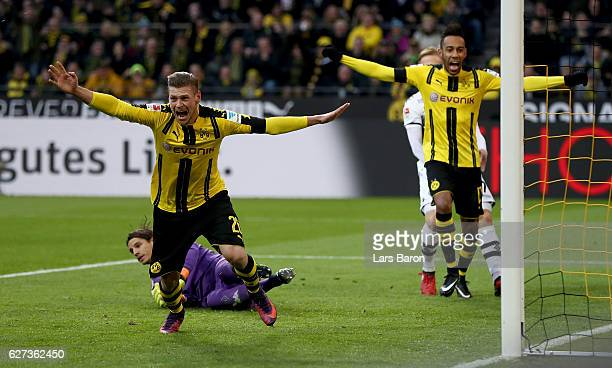 Lukasz Piszczek of Borussia Dortmund celebrates after scoring his teams second goal during the Bundesliga match between Borussia Dortmund and...