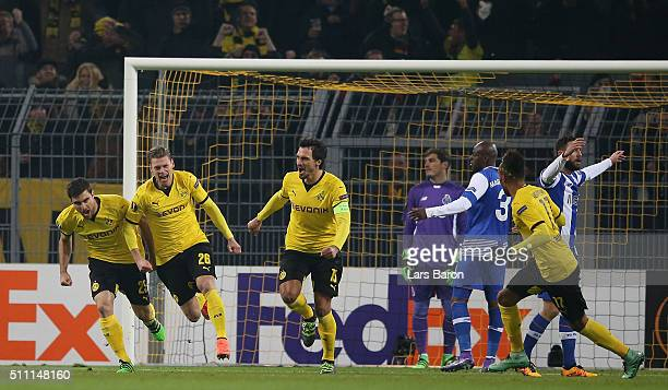 Lukasz Piszczek of Borussia Dortmund celebrates scoring his team's first goal during the UEFA Europa League round of 32 first leg match between...