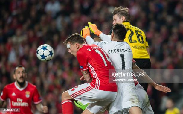 Lukasz Piszczek of Borussia Dortmund challenges goal keeper Ederson and Victor Lindeloef of SL Benfica during the UEFA Champions League Round of 16...