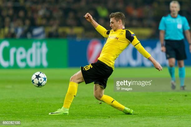 Lukasz Piszczek of Borussia Dortmund controls the ball during the UEFA Champions League Round of 16 Second Leg match between Borussia Dortmund and SL...