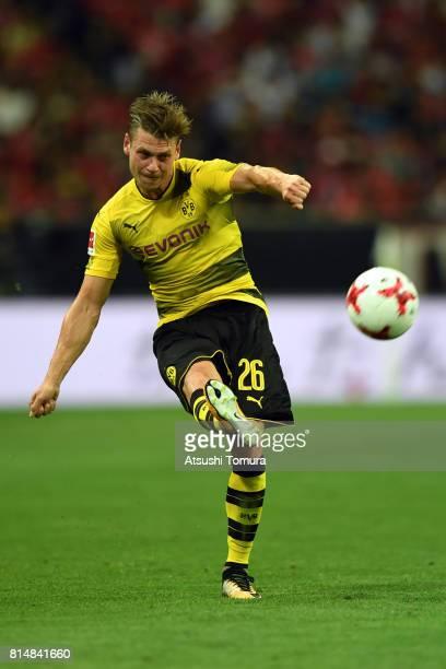 Lukasz Piszczek of Borussia Dortmund passes the ball during the preseason friendly match between Urawa Red Diamonds and Borussia Dortmund at Saitama...