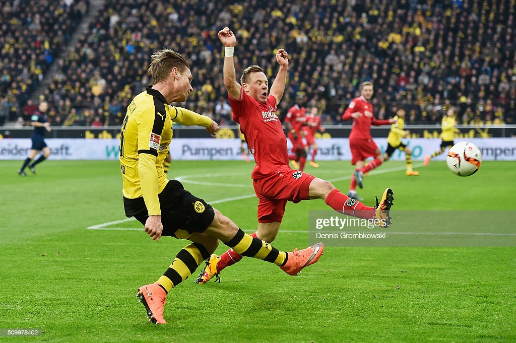 <a gi-track='captionPersonalityLinkClicked' href=/galleries/search?phrase=Lukasz+Piszczek&family=editorial&specificpeople=4380352 ng-click='$event.stopPropagation()'>Lukasz Piszczek</a> of Borussia Dortmund passes the ball past Uffe Bech of Hannover 96 during the Bundesliga match between Borussia Dortmund and Hannover 96 at Signal Iduna Park on February 13, 2016 in Dortmund, Germany.