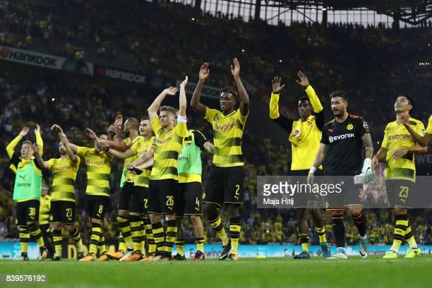 Lukasz Piszczek of Dortmund and DanAxel Zagadou of Dortmund and players of Dortmund celebrate with their fans after the Bundesliga match between...