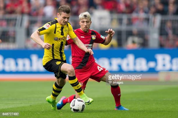 Lukasz Piszczek of Dortmund and Kevin Kampl of Bayer Leverkusen battle for the ball during the Bundesliga match between Borussia Dortmund and Bayer...