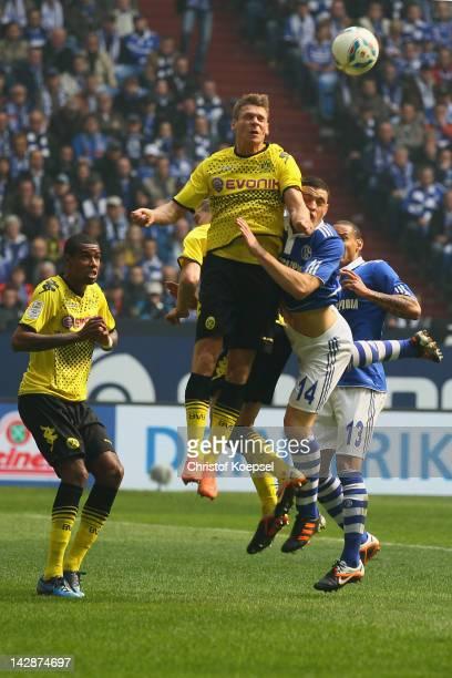 Lukasz Piszczek of Dortmund and Kyriakos Papadopoulos of Schalke go up for a header during the Bundesliga match between FC Schalke 04 and Borussia...