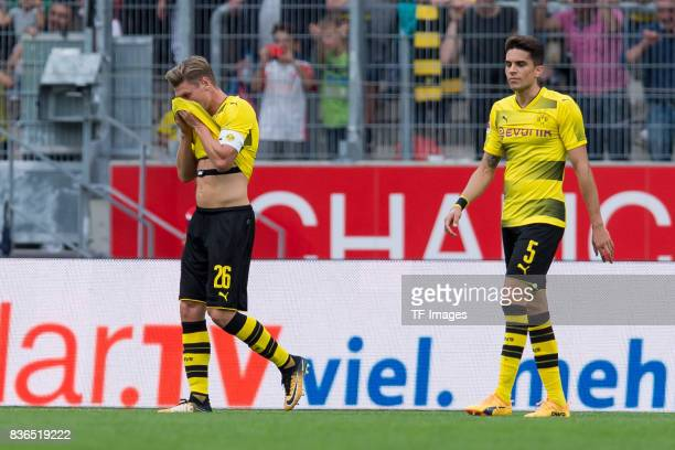 Lukasz Piszczek of Dortmund and Marc Bartra of Dortmund looks dejected during the preseason friendly match between RotWeiss Essen and Borussia...