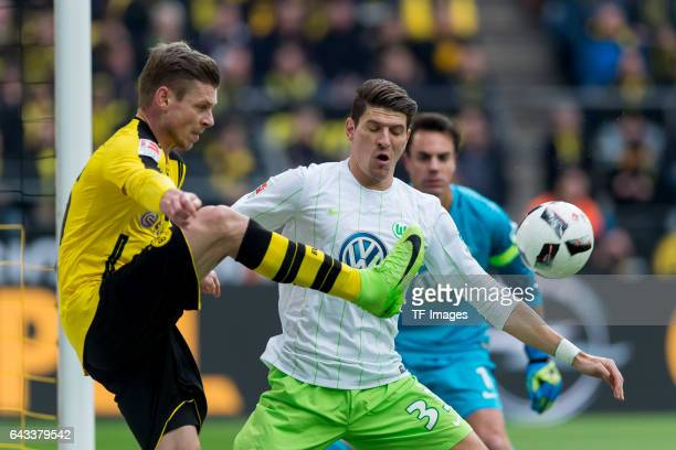 Lukasz Piszczek of Dortmund and Mario Gomez battle for the ball during the Bundesliga match between Borussia Dortmund and VfL Wolfsburg at Signal...