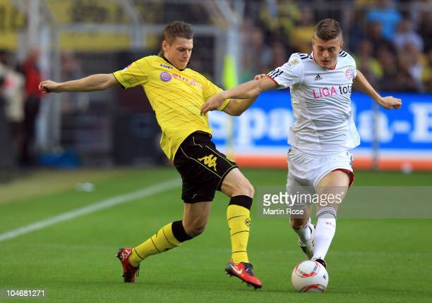 Lukasz Piszczek of Dortmund and Toni Kroos of Muenchen battle for the ball during the Bundesliga match between Borussia Dortmund and FC Bayern...