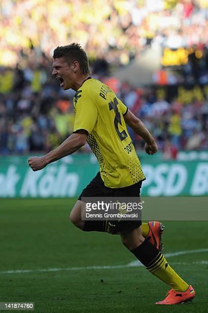 Lukasz Piszczek of Dortmund celebrates after scoring his team's first goal during the Bundesliga match between 1 FC Koeln and Borussia Dortmund at...