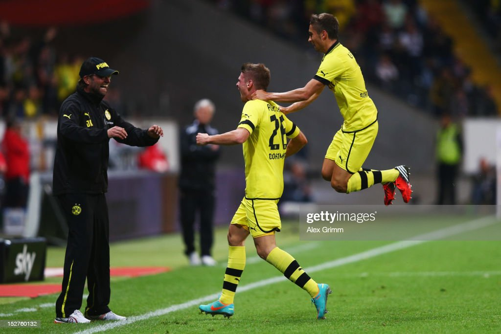 <a gi-track='captionPersonalityLinkClicked' href=/galleries/search?phrase=Lukasz+Piszczek&family=editorial&specificpeople=4380352 ng-click='$event.stopPropagation()'>Lukasz Piszczek</a> (C) of Dortmund celebrates his team's first goal with head coach Juergen Klopp and team mate <a gi-track='captionPersonalityLinkClicked' href=/galleries/search?phrase=Moritz+Leitner&family=editorial&specificpeople=7118695 ng-click='$event.stopPropagation()'>Moritz Leitner</a> during the Bundesliga match between Eintracht Frankfurt and Borussia Dortmund at Commerzbank-Arena on September 25, 2012 in Frankfurt am Main, Germany.