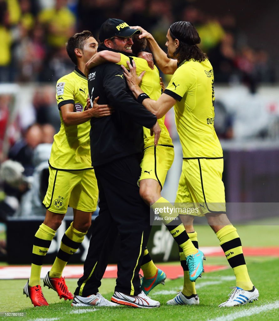 Lukasz Piszczek of Dortmund celebrates his team's first goal with head coach Juergen Klopp and team mates Moritz Leitner and Neven Subotic during the...