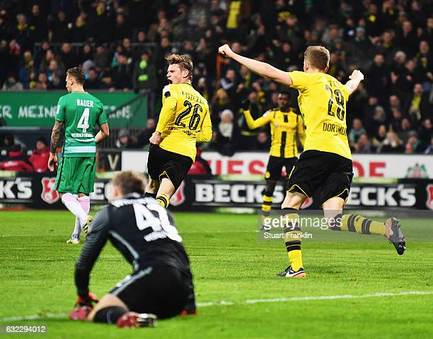 Lukasz Piszczek of Dortmund celebrates scoring the second goal during the Bundesliga match between Werder Bremen and Borussia Dortmund at...