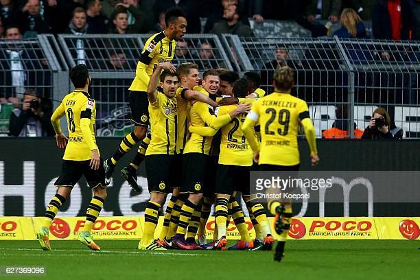 Lukasz Piszczek of Dortmund celebrates the second goal with his team mates during the Bundesliga match between Borussia Dortmund and Borussia...