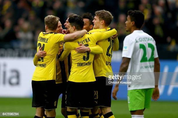 Lukasz Piszczek of Dortmund celebrates the second goal with his team mates during the Bundesliga match between Borussia Dortmund and VfL Wolfsburg at...