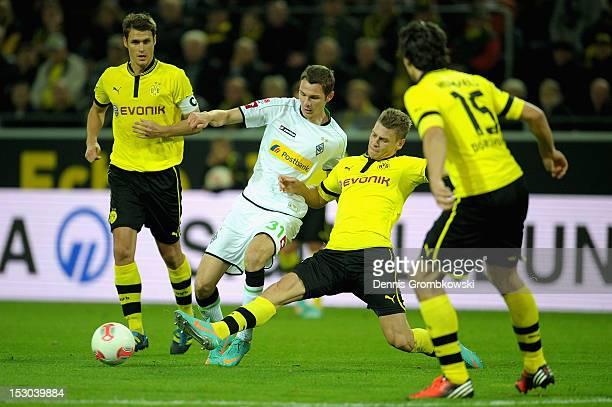 Lukasz Piszczek of Dortmund challenges Branimir Hrgota of Moenchengladbach during the Bundesliga match between Borussia Dortmund and VfL Borussia...