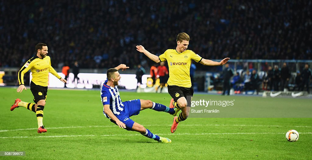 <a gi-track='captionPersonalityLinkClicked' href=/galleries/search?phrase=Lukasz+Piszczek&family=editorial&specificpeople=4380352 ng-click='$event.stopPropagation()'>Lukasz Piszczek</a> of Dortmund challenges <a gi-track='captionPersonalityLinkClicked' href=/galleries/search?phrase=Vedad+Ibisevic&family=editorial&specificpeople=535857 ng-click='$event.stopPropagation()'>Vedad Ibisevic</a> of Berlin during the Bundesliga match bewteen Hertha BSC and Borussia Dortmund at Olympiastadion on February 6, 2016 in Berlin, Germany.