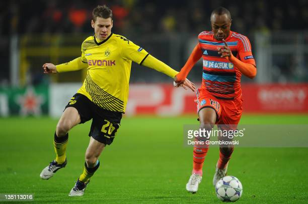 Lukasz Piszczek of Dortmund chases Andre Ayew of Marseille during the UEFA Champions League group F match between Borussia Dortmund and Olympique de...