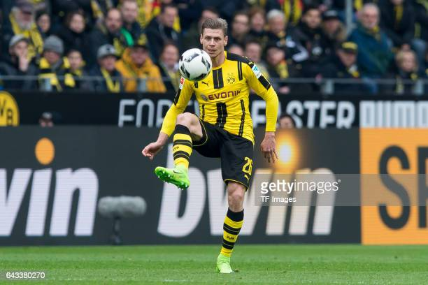 Lukasz Piszczek of Dortmund controls the ball during the Bundesliga match between Borussia Dortmund and VfL Wolfsburg at Signal Iduna Park on...