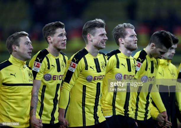 Lukasz Piszczek of Dortmund is seen with tema mates after winning the Bundesliga match between Borussia Dortmund and FC Ingolstadt 04 at Signal Iduna...